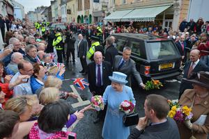 ENNISKILLEN, NORTHERN IRELAND - JUNE 26:  Queen Elizabeth II receives floral posies from wellwishers as she and Prince Philip, Duke of Edinburgh visit Macartin's Cathedral on June 26, 2012 in Enniskillen, Northern Ireland. The Queen and Duke of Edinburgh, on a Diamond Jubilee visit to Northern Ireland, are due to meet with former IRA leader and NI's Deputy First Minister Martin McGuinness.  (Photo by Jeff J Mitchell/Getty Images)