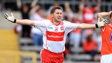 Conleith Gilligan wheels away in celebration after he netted Derry's third goal in their convincing victory over Armagh in Clones yesterday