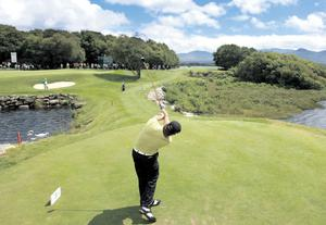 In the swing: Graeme McDowell gets in some practice yesterday
