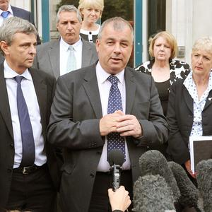 Brendan Barber, TUC general secretary, talks to the waiting media outside the Cabinet Office in Westminster