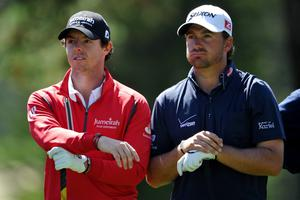 SAN FRANCISCO, CA - JUNE 12:  Rory McIlroy (L) and Graeme McDowell of Northern Ireland wait on a tee box during a practice round prior to the start of the 112th U.S. Open at The Olympic Club on June 12, 2012 in San Francisco, California.  (Photo by Stuart Franklin/Getty Images)