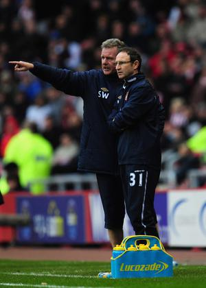 SUNDERLAND, ENGLAND - DECEMBER 11:  New Sundeland manager Martin O' Neill (r) and assistant Steve Walford react during the Barclays premier league game between Sunderland and Blackburn Rovers at Stadium of Light on December 11, 2011 in Sunderland, England.  (Photo by Stu Forster/Getty Images)