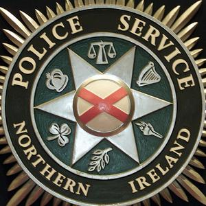 Police are investigating after a man was found beaten and tied to railings in Belfast