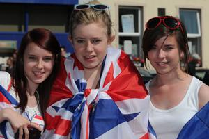Lauren Murphy, Megan Boucher and Emma McGraw enjoy the summer sunshine at the County Londonderry Twelfth celebration in Limavady on tuesday. PIcture Martin McKeown. Inpresspics.com. 12.7.11