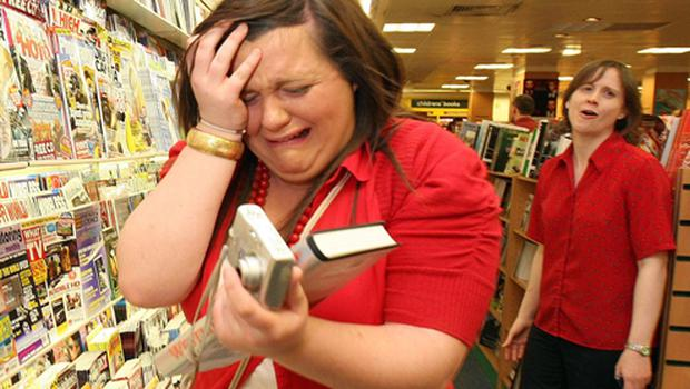It's all too much for one fan during the Westlife book signing in Eason's Donegall Place store in Belfast