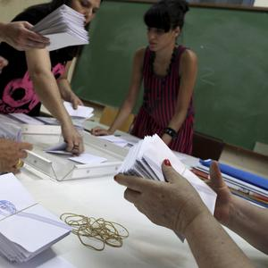 Election officials count ballots during parliamentary elections at a polling station, in Athens (AP)
