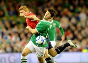 Norway's John Arne Riise tussles with Ireland's Shane Long during the International Friendly at the AVIVA Stadium, Dublin, Ireland. PRESS ASSOCIATION Photo. Picture date: Wednesday November 17, 2010. See PA story SOCCER Republic. Photo credit should read: Barry Cronin/PA Wire.