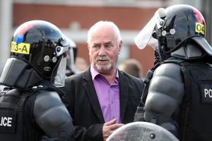 Press Eye - Belfast - Northern Ireland -   Sunday 2nd August  2012- Picture by Kelvin Boyes / Press Eye.Disturbance between Loyalists and Republicans at the Carlisle Circus area of north Belfast following a parade in the area.PUPs Ken Wilkinson speaks with police officers