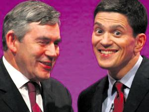 Gordon Brown jokes with David Miliband - the man who could now replace him as Labour leader
