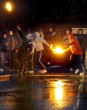 Police come under petrol bomb attack during rioting in the Ardoyne area of north Belfast