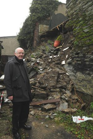 Michael Carlin, from Harding Street in Derry at the rear of his house where a section of wall has collapsed. 16.12.11
