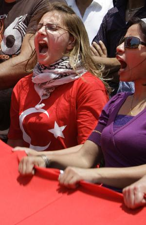 Turkish women shout anti-Israeli slogans during a protest in front of the UN house in Beirut, Lebanon, Monday, May 31, 2010