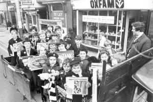 Pupils from Fullerton House, Methodist College, Belfast, representing each class from P1 to P7 under the supervision of teacher Roy Topping (right) delivered 1,500 toys collected at the school as pasrt of BBC TV's Blue Peter appeal to Oxfam shop in Chichester Street, 1979.