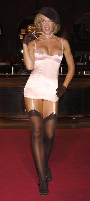 Nell McAndrew on the catwalk during the Agent Provocateur charity fashion show