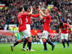 Manchester United's Paul Scholes (right) celebrates with team-mates Ryan Giggs (centre) and Antonio Valencia after scoring his side's second goal during the Barclays Premier League match at Old Trafford, Manchester