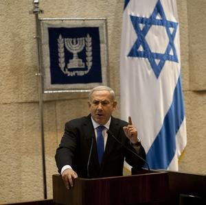 Israeli prime minister Benjamin Netanyahu delivers a speech before the parliament dissolved itself (AP Photo/Sebastian Scheiner)