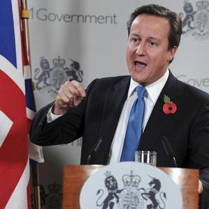 David Cameron gestures while speaking at an EU summit in Brussels (AP)