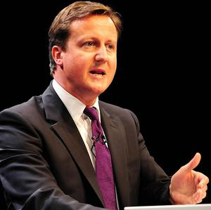 David Cameron has backed calls for an inquiry into phone hacking at the News of the World