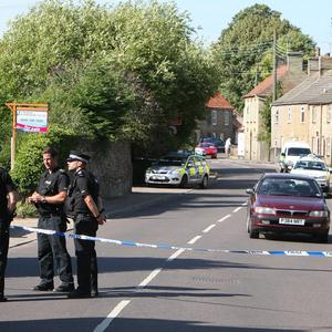 Police forensics officers at the scene in Feltwell, Norfolk, after a woman was shot twice in the forehead