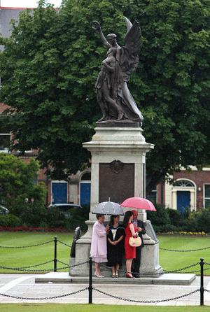 Queens University summer Graduation. July 2010. Shelter from the drizzle.