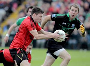 Donal O'Hare (left) was called into the Down ranks against Fermanagh