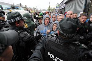Press Eye Belfast - Northern Ireland -  Tuesday 12th  July 2011 -  Bandsmen and members of the Orange Order pass Nationalist Protestors at a contentious flashpoint in Ardoyne, north Belfast as part of the annual 12th July parades across Northern Ireland.Nationalist protestors confront police.Picture by Kelvin Boyes / Press Eye.