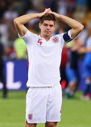 KIEV, UKRAINE - JUNE 24: Steven Gerrard of England looks dejected after the penalty shoot out during the UEFA EURO 2012 quarter final match between England and Italy at The Olympic Stadium on June 24, 2012 in Kiev, Ukraine.  (Photo by Alex Livesey/Getty Images)