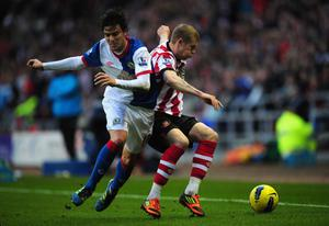 SUNDERLAND, ENGLAND - DECEMBER 11:  Blackburn player Mauro Formica (l) battles with James McClean  of Sunderland during the Barclays premier league game between Sunderland and Blackburn Rovers at Stadium of Light on December 11, 2011 in Sunderland, England.  (Photo by Stu Forster/Getty Images)