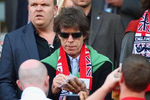 Rolling Stones singer Mick Jagger signs autographs at the England v Germany second round match, World Cup 2010