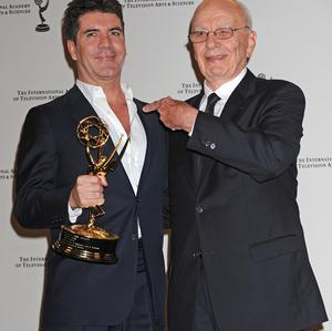 Simon Cowell poses with his International Emmy award with media magnate Rupert Murdoch (AP)