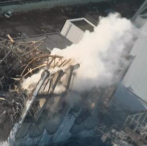 Thick while smoke billows from the No 3 unit of the Fukushima Dai-ichi nuclear power plant in Japan (AP/Tokyo Electric Power)