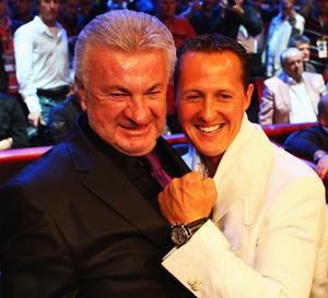 Manager Willy Weber (left) and Formula One legend Michael Schumacher pose for a photo ahead to the WBA Middleweight World Championship fight between Felix Sturm of Germany and Khoren Gevor of Armenia at Nuerburgring on July 11, 2009 in Nuerburg, Germany
