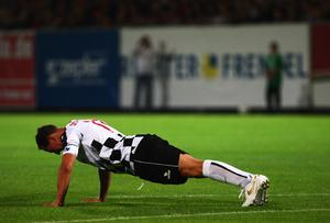 Formula One legend Michael Schumacher makes push ups during the charity football match between Nazionale Piloti and biggALLSTARS at Brita Arena on July 8, 2009 in Wiesbaden, Germany