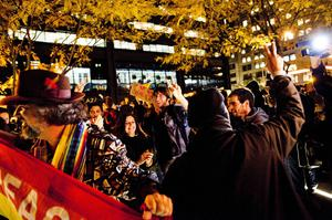 NEW YORK, NY - NOVEMBER 15: Protesters celebrate after re-entering Zuccotti Park on November 15, 2011 in New York City. Police had removed the protesters from the park early in the morning. A judge ruled that protesters are allowed back to the park but won't be allowed to camp there. Hundreds of protesters, who rallied against inequality in America, have slept in tents and under tarps since September 17 in Zuccotti Park, which has since become the epicenter of the global Occupy movement. The raid in New York City follows recent similar moves in Oakland, California, and Portland, Oregon.  (Photo by Michael Nagle/Getty Images)