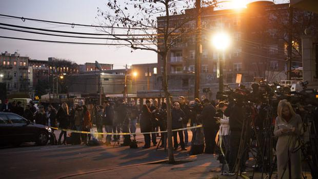 HOBOKEN, NJ - DECEMBER 14:  Members of the media converge in front of an apartment at 1313 Grand Street, believed to be connected to the Connecticut elementary school shooting, on December 14, 2012 in Hoboken, New Jersey.  According to reports, there are 27 dead, including 20 children, after a gunman opened fire in at the Sandy Hook Elementary School in Newtown, Connecticut. The shooter, identified as Adam Lanza, was also found dead at the scene.  (Photo by Michael Nagle/Getty Images)