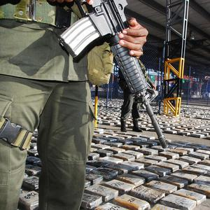 Police officers guard packages of seized cocaine in Barranquilla, Colombia (AP)