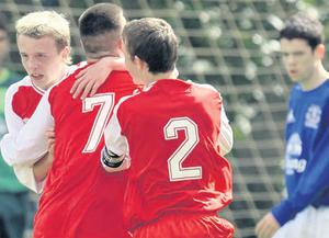 Shock troops: Co Antrim's Rhys Clelland celebrates with team-mates after scoring against Everton