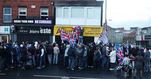 Northern Ireland- 4th December 2012 Mandatory Credit - Photo-Jonathan Porter/Presseye.  Loyalist hold protest at Naomi Long's east Belfast Alliance office following a council vote last night which will see the Union Flag only follow certain days.  Loyalist protesters pictured on the Newtownards Road during the protest.