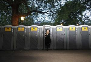 Jordan Lee from Jackson Mississippi emerges from a temporary lavatory after spending the night along the Royal Wedding route in London Friday, April, 29, 2011. (AP Photo/Elizabeth Dalziel)