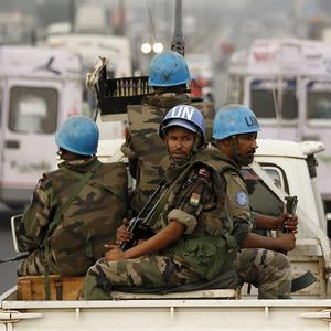 United Nations soldiers conduct a patrol through the streets of Abidjan, Ivory Coast (AP/Rebecca Blackwell)
