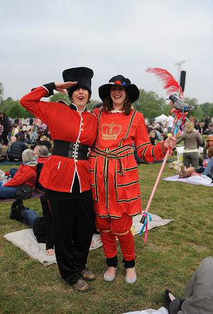 LONDON, ENGLAND - APRIL 29:  Two girls dressed as a Guard and a Beefeater pose for the camera in Hyde Park as they wait to watch the Royal Wedding of Prince William to Catherine Middleton at Westminster Abbey on April 29, 2011 in London, England. The marriage of the second in line to the British throne is to be led by the Archbishop of Canterbury and will be attended by 1900 guests, including foreign Royal family members and heads of state. Thousands of well-wishers from around the world have also flocked to London to witness the spectacle and pageantry of the Royal Wedding.  (Photo by Christopher Lee/Getty Images)