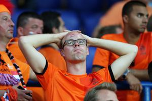 KHARKOV, UKRAINE - JUNE 09:  Dutch fans look dejected at the final whistle the UEFA EURO 2012 group B match between Netherlands and Denmark at Metalist Stadium on June 9, 2012 in Kharkov, Ukraine.  (Photo by Julian Finney/Getty Images)