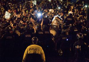 PORTLAND, OR - NOVEMBER 13: Police attempts to disperse a thick crowd at Occupy Portland November 13, 2011 in Portland, Oregon.  In spite of an eviction notice for early Sunday morning, Portland police delayed closing two downtown parks early today as thousands of people converged to support the Occupy Portland movement. (Photo by Natalie Behring/Getty Images)