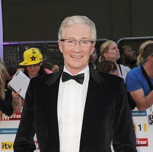 Paul O'Grady keeps several dogs, sheep, pigs, goats, ducks, chickens and barn owls on his Kent farm