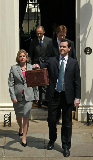 British Chancellor of the Exchequer George Osborne holds Gladstone's original budget box as he leaves No 11 Downing Street with his treasury team on June 22, 2010 in London, England