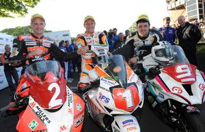 Third placed Ryan Farquhar with winner John McGuinness and second placed Michael Dunlop after the Superstock race
