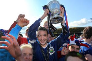 Linfield's captain Michael Gault lifts the Gibson Cup