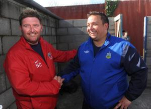 Ards Manager Niall Currie and Ards Rangers Manager Lee Forsythe chat after the game had to be abandoned due to the referee Keith Kennedy being unable to continue following an ankle injury