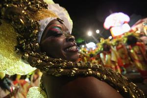 SALVADOR, BRAZIL - FEBRUARY 17:  Revelers parade on the second day of Carnival celebrations on February 17, 2012 in Salvador, Brazil. Carnival is the grandest holiday in Brazil, annually drawing millions in raucous celebrations culminating on Fat Tuesday before the start of the Catholic season of Lent which begins on Ash Wednesday. Salvador is the capital of the Northeastern state of Bahia and was the first colonial capital of Brazil.Police strikes in Salvador and Rio de Janiero in recent weeks threatened Carnival and raised questions about the countryÄôs preparedness to host the upcoming 2014 World Cup and 2016 Summer Olympics. Rio de JanieroÄôs Carnival began today, a day later than SalvadorÄôs.  (Photo by Mario Tama/Getty Images)