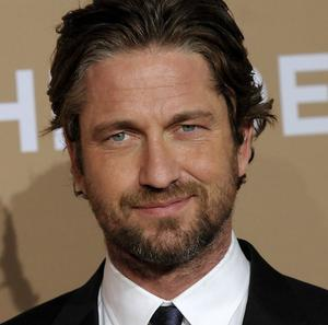 Actor Gerard Butler presented an award to the Scottish founder of a charity